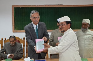 AMU VC Gen. Zammer Uddin Shah releasing the book Afkar-i-Sir Syed Ki Asri Maanwiyat authored by Dr. Tauqueer Alam Falahi